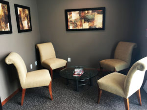 Y Wellness Plymouth Minnesota common area sitting room chairs relax comfortable chiropractic chiropractor office clinic