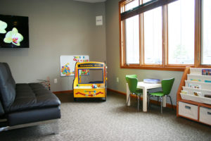 Y Wellness Plymouth Minnesota Kids Area with toys couch table television for families children kids babies newborn infant pregnancy chiropractic chiropractor massage therapy