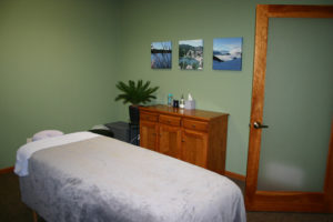 Y Wellness Plymouth Minnesota massage room massage therapy table relaxing healing pain relief benefits neuromuscular